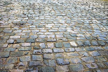 closeup photo of black and gray concrete pavement