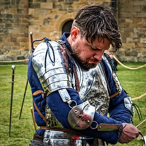 shallow focus photography of man in silver armor