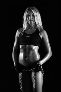 grayscale photo of woman in black Nike sports bra