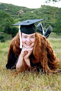 woman wearing black graduation hat