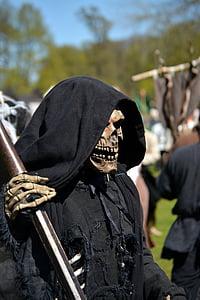 person in grim reaper costume