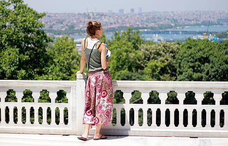 woman standing near railings during daytime