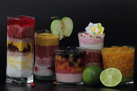 five assorted deserts on clear glass cups