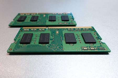 two green RAM sticks on white surface