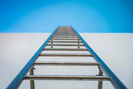 low angle photography of silver ladder