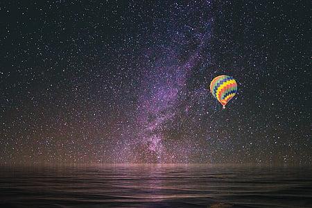 multicolored hot air balloon sailing during nighttime
