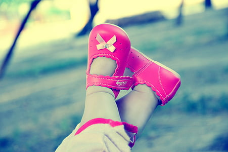 toddler wearing pair of pink leather shoes