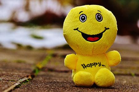 macro photo of yellow emoji plush toy