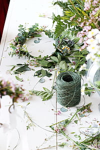 white flowers with yarn
