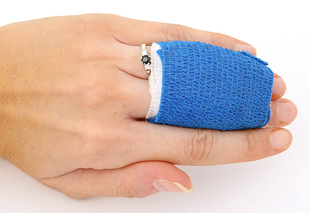 human hand with blue bandage