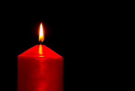 lighted red pillar candle