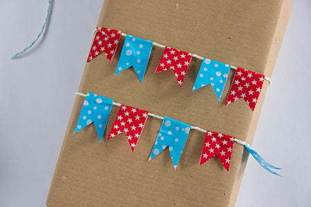 red and blue ribbon strap on box