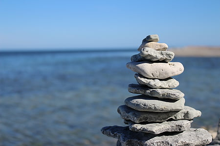 stack of stone near body of water