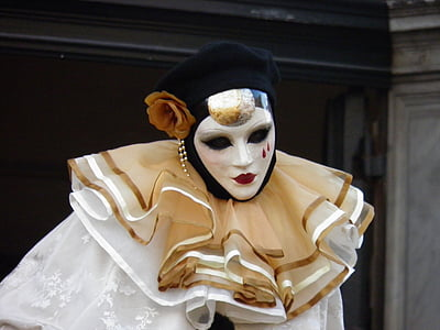 clown wearing white and brown dress