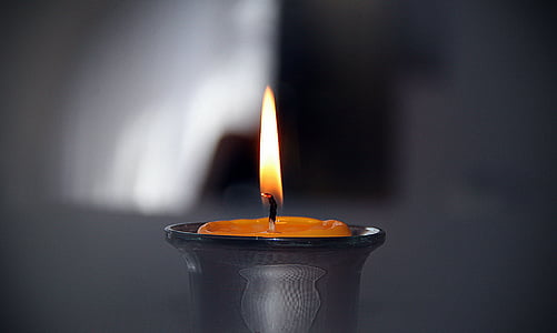lighted candle in close up photography