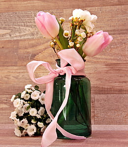 two pink and one white flowers on green vase