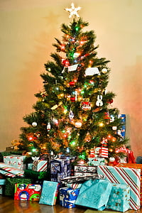 lighted christmas tree with gifts