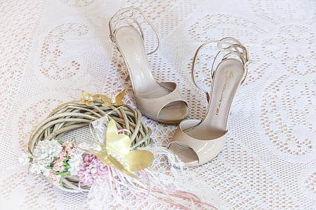 pair of women's white leather peep-toe stilettos