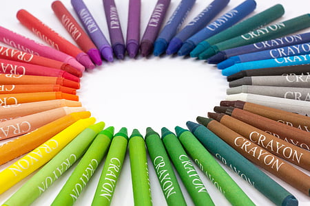 assorted-color crayon lot on white surface