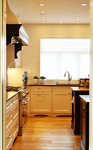 white wooden kitchen cabinet behind white painted wall