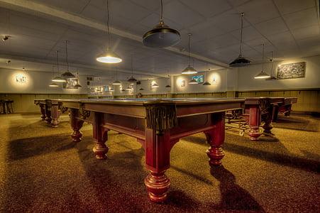 brown wooden pool tables inside room