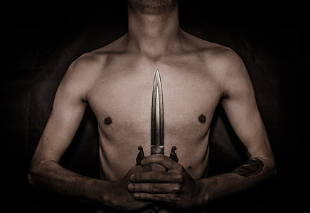 man holding dagger