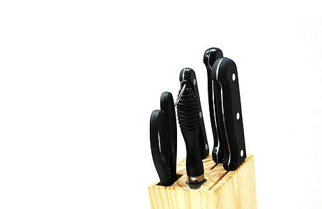 black handle knife set in beige knife block