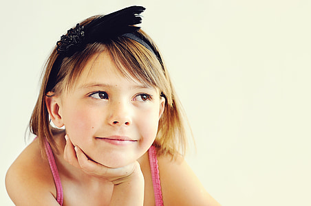 blonde girl wearing pink sleeveless top