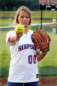 shallow focus photography of woman holding green baseball