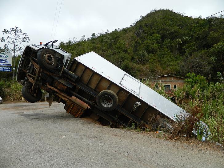 crashed white box truck at daytime