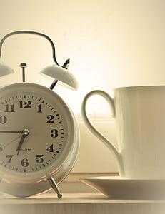 white analog alarm clock