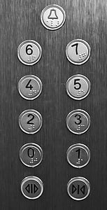 close shot of gray elevator buttons