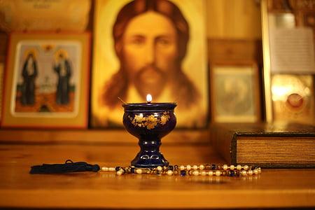 brown tesbih prayer beads beside book