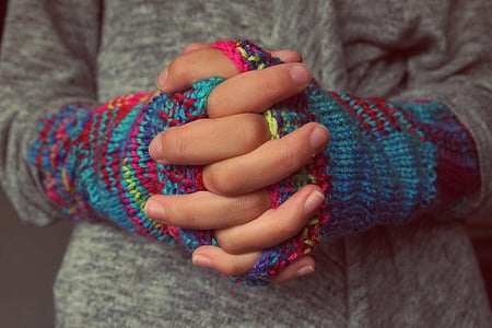 person wearing multicolored gloves