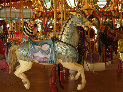 photo of beige and green horse carousel