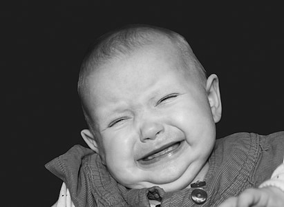 crying baby on grayscale photography
