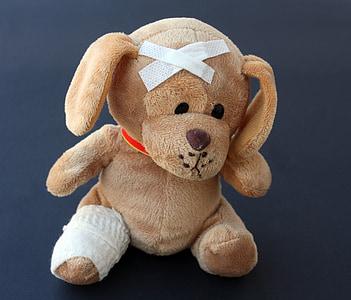 brown dog plush toy on black background