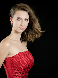 woman wearing red strapless dress