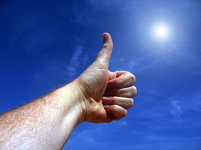 thumbs up during daytime