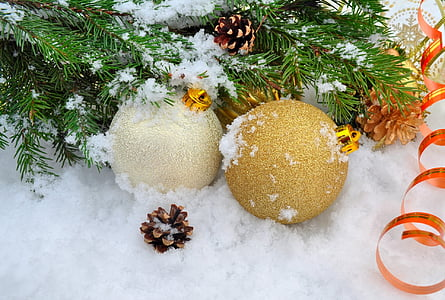 two Christmas bauble surrounding with snow