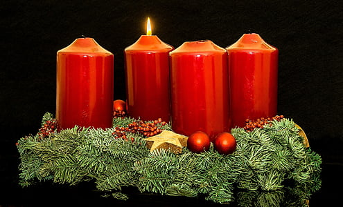 four red candle figurine