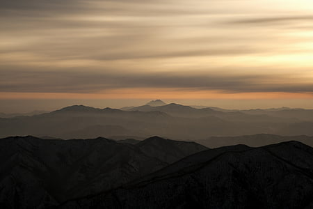 silhouette photo of mountains during golden hour