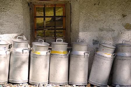 lined gray milk churns