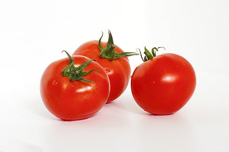 three red cherry tomatoes