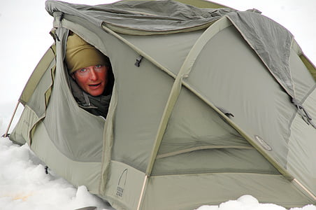 woman inside the gray tent