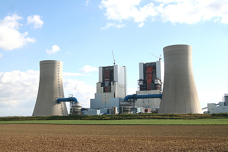 two gray power plant standing next to each other