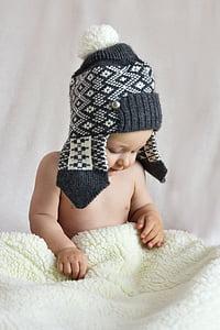 toddler holding blanket