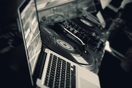 grayscale photography of MacBook and turntable