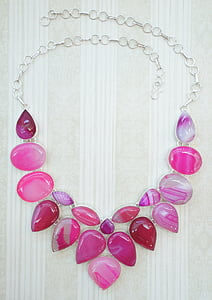 silver-colored necklace with pink stones