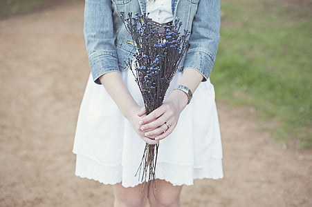 person holding blue flower bouquet